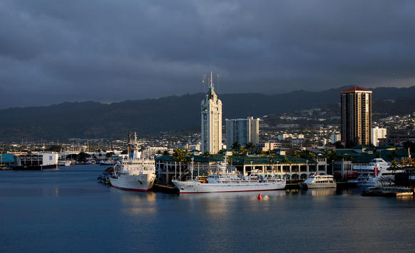 The 1926 Aloha Tower, center. The aptly named 10-story-tall lighthouse and clock tower, built in a style known as Hawaiian Gothic, is Honolulu's version of New York C
