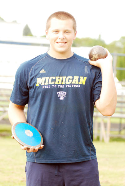 Petoskey freshman Tommy Roush set a Petoskey High School boys' track and field school record in the shot put with a throw of 55 feet, 11 inches at Wednesday's weather-shortened three-team Big North Conference meet at Cadillac.