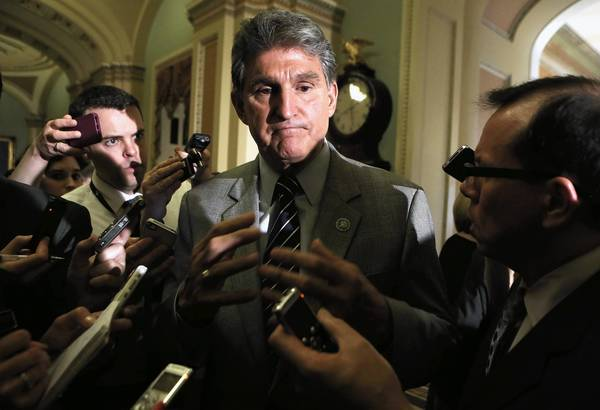 Sen. Joe Manchin (D-W.V.) speaks Wednesday after the Senate defeated a bipartisan proposal by him and Sen. Pat Toomey (R-Pa.) to expand background checks on firearms purchases and close the so-called gun show loophole.