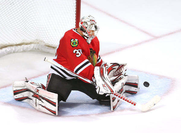 Blackhawks goalie Ray Emery makes a stop during the second period of his team's game against the Stars at the United Center.
