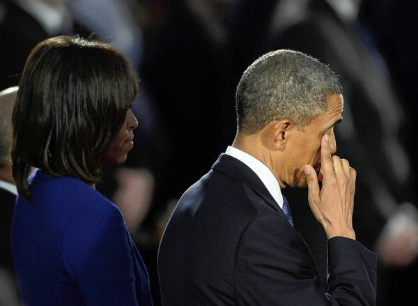 President Obama and First Lady Michelle Obama attend an interfaith service honoring bombing victims at the Cathedral of the Holy Cross in Boston.