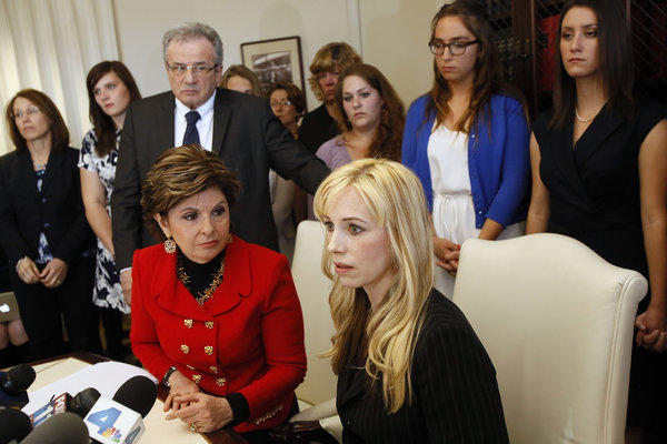 "LOS ANGELES, CA - APRIL 18, 2013: Attorney Gloria Allred, left sitting and Dr. Caroline Heldman, professor of politics, along with 6 sexual assault victims at a news conference to announce the filing of a complaint against Occidental as a result of what the women allege is the college's ""Deliberate indifference to rape victims."""