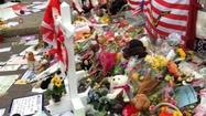 BOSTON -- Since the events of the last few days, Dominick DiLuzio, 23, has taken to wandering the streets of Boston. In particular, he's been drawn to the corner of Boylston and Berkeley streets, where a barrier is erected since the streets are still closed, and a memorial has been growing since Tuesday.