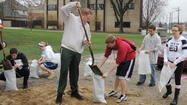 Elmhurst volunteers fill sandbags