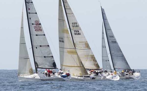 Sailing crews are side by side moments after crossing the starting line in last year's Newport to Ensenada race.