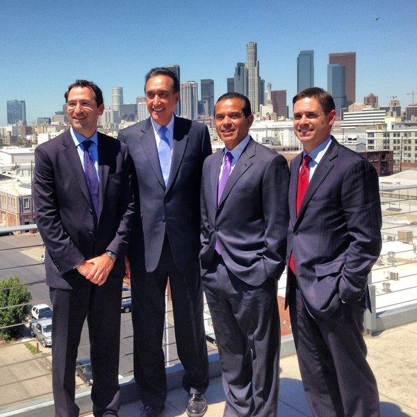 Jon Gray, left, global head of real estate for Blackstone Group, poses at the Barker Block condominium project with CityView Chairman Henry Cisneros, L.A. Mayor Antonio Villaraigosa and CityView President Sean Burton.