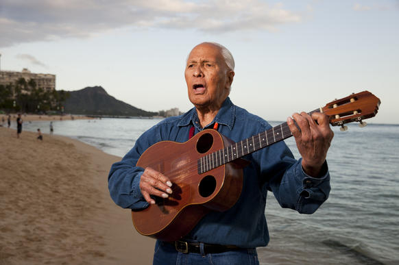 Ukulele legend Eddie Kamae plays a few songs on Waikiki Beach.
