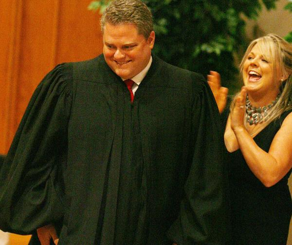 Michael Rudisill at his investiture ceremony as judge of the 18th Judicial Circuit of Florida in 2009. His wife Summer celebrates with him.