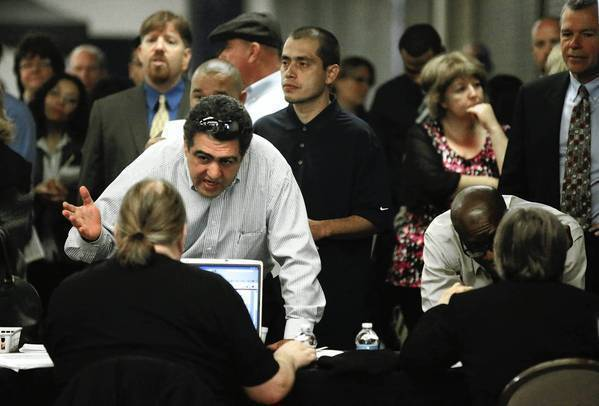California's unemployment insurance fund has been hammered by the worst economic crisis since the Great Depression. Above, job seekers attend a career expo in Anaheim last month.