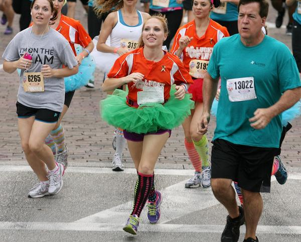 Colorfully-dressed athletes run during the IOA Corporate 5K run in downtown Orlando on Thursday, April 18, 2013. (Stephen M. Dowell/Orlando Sentinel)