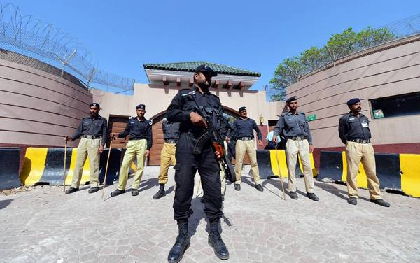 Pakistani police stand guard outside the villa of former President Pervez Musharraf on the edge of Islamabad.