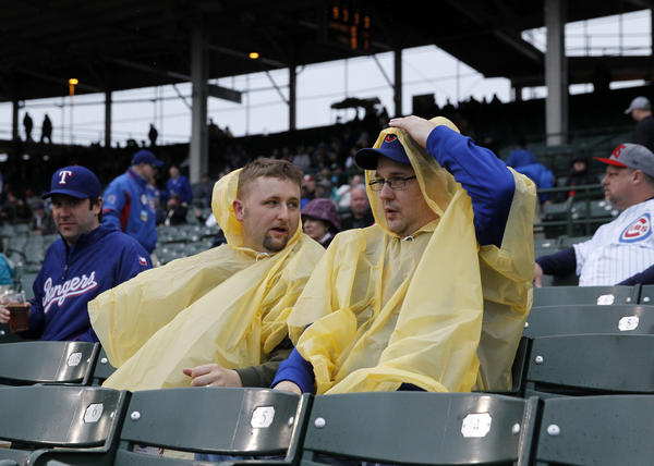 Fans brave the rain at Wrigley on Thursday.