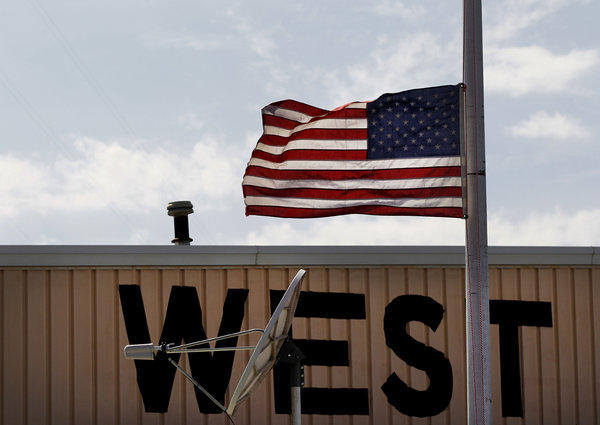 A flag is flown at half staff in West, Texas, near the fertilizer plant that exploded Wednesday night in the town of 2,800.