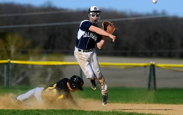 Salisbury infielder Nicolas Ampietro (top) leaps over Northwestern's Nicholas Rodriguez to complete a double play on Wednesday. Ampietro wears a protective mask because of a head injury he suffered last season.