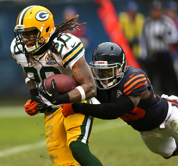 Bears cornerback D.J. Moore (right) tries to tackle Green Bay running back Alex Green last season.