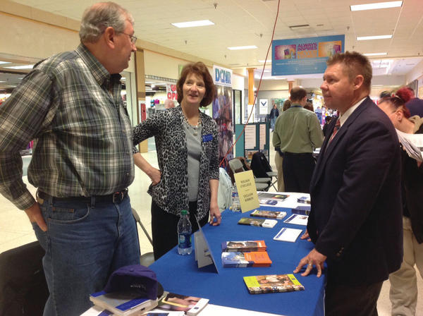 Al Berberich and Mary Foltz Berberich talk to state Sen. Richard Alloway during Alloway's job fair Thursday north of Chambersburg, Pa. Mary Foltz Berberich works for Wilson College.