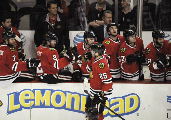 Viktor Stalberg is greeted by his teammates after scoring a goal against the Stars.