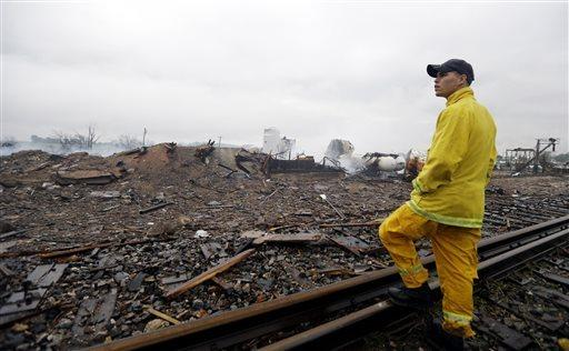 A firefighter surveys the remains of a fertilizer plant destroyed by an explosion in West, Texas.