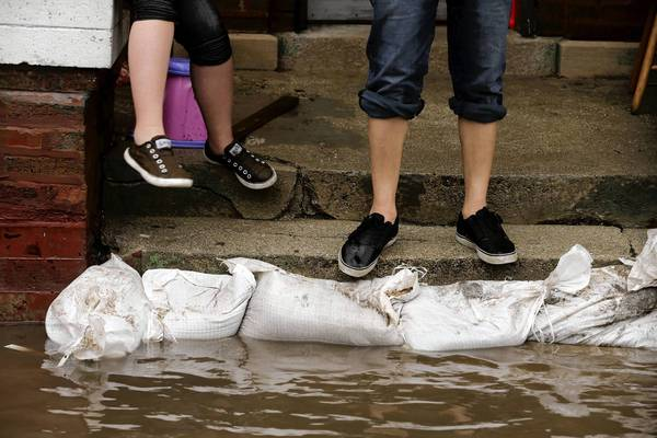 Sandbags help to hold back flood water at a home on the 4900 block of north Drake in Albany Park.Heavy rain caused massive flooding in and around the Chicago area.