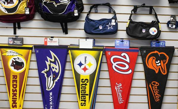 At Main Street's Sports Card Heroes, Orioles and Nationals pennants share a display wall with pennants from another Baltimore-Washington sports rivalry: Redskins and Ravens.