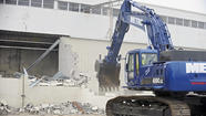 With the swipe of an excavator, a demolition crew began taking down the abandoned Solo Cup factory in Owings Mills on Thursday, work that will clear the way for new development that was once threatened by opposition.