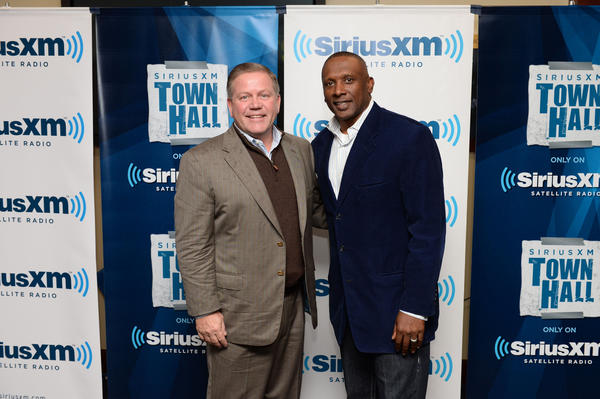 "Brian Kelly, left, poses with Tim Brown at ""SiriusXM's Notre Dame Town Hall with Brian Kelly"" on Thursday night at Notre Dame Stadium. (Getty Images/DAN BOCZARSKI)"
