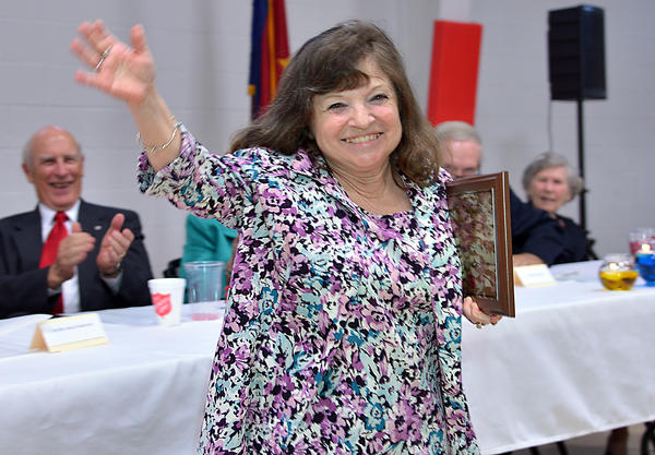 Peggy Huff reacts to the announcement Thursday evening that she was named volunteer of the year for 2012 by The Salvation Army of Washington County during the organization's annual appreciation dinner at its new Shifler Family Community Center in Hagerstown.