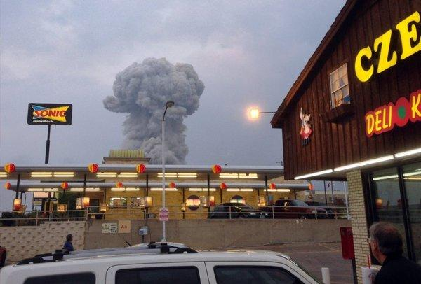 Smoke from the fertilizer plant explosion rises near the Czech Stop, a favored gathering place in the town of West, Texas