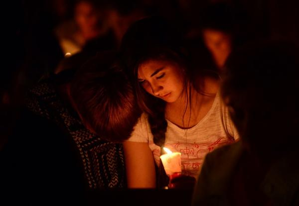 People gather for a candlelight vigil at St. Mary's Catholic Church in West, Texas, in memory of those killed by the fertilizer plant explosion.