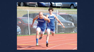Windber's Matt Barkley hands the baton to Trevor Neri on the way to winning the boys 4x100 relay on Thursday against Berlin.