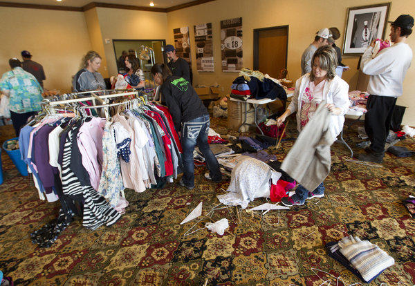 Volunteers gather at the Best Western in West, Texas, to sort out donations for the victims of the Wednesday night explosion at West Fertilizer Co.
