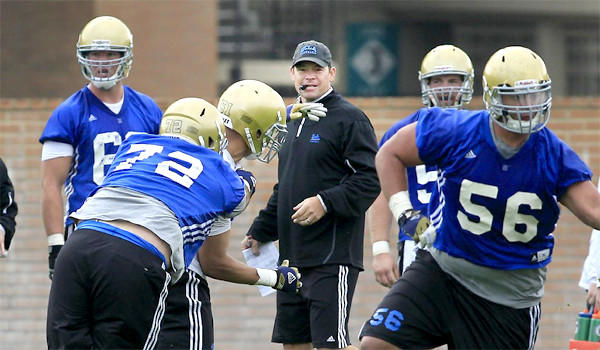 "Jim Mora's UCLA Bruins football team has caught the injury bug, ""We had more guys riding the [stationary] bike on the side than we had on the field today,"" the coach said."