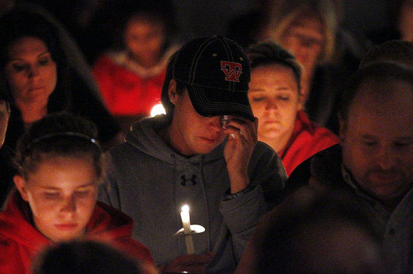 People mourn and pray during a candlelight vigil Thursday night at Assumption Catholic Church in West, Texas, for victims of the recent fertilizer plant explosion.