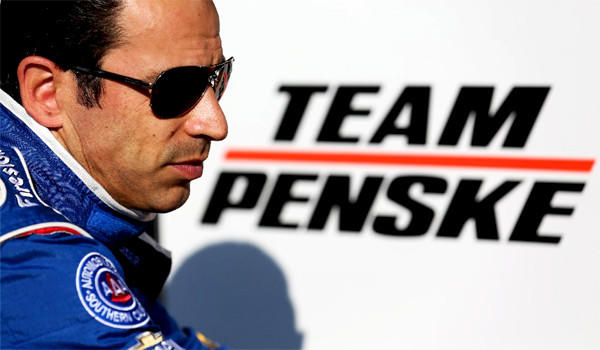 Team Penske driver Helio Castroneves sits on pit wall after practice for the Honda Indy Grand Prix of Alabama at Barber Motorsports Park on April 6, 2013.
