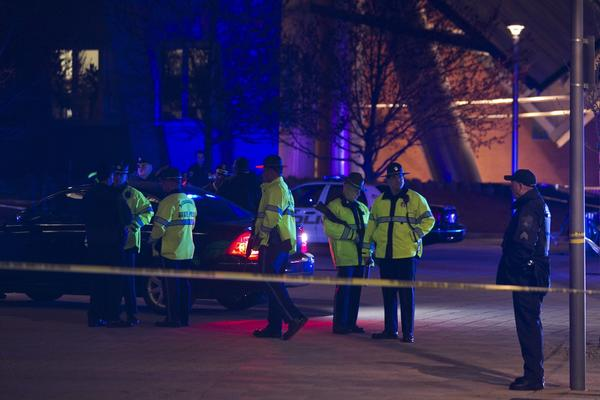 Police investigate the scene of the shooting of a Massachusetts Institute of Technology police officer in Cambridge.