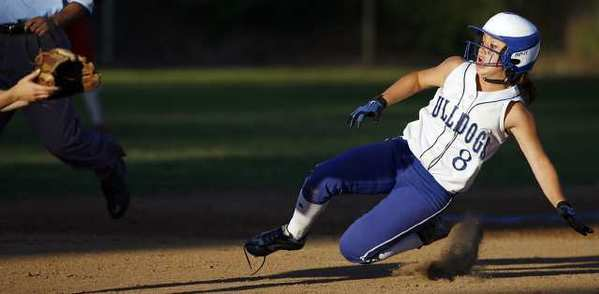 Burbank's Lily Winn slides to second base during a game against Burroughs at McCambridge Park in Burbank on Thursday, April 18, 2013.