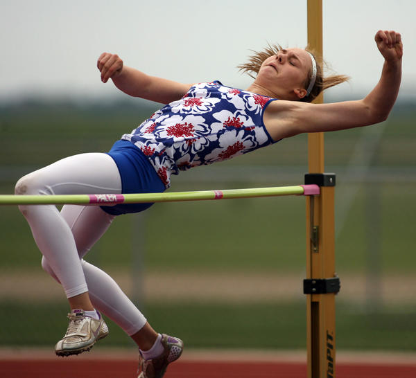 Colette Christensen, of Rapid City, approaches the bar in the high jump event in the heptathlon competition Thursday at the Junior Olympic Track and Field Championships at Swisher Field. photo by john davis taken 6/9/2011
