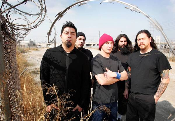 Chi Cheng, right, is shown with the Deftones. From left are Chino Moreno, Frank Delgado, Abe Cunningham and Stef Carpenter.