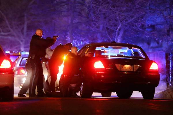 Police search for a suspect in Watertown, Mass., after the fatal shooting of a campus police officer at MIT in Cambridge followed by a carjacking. It was unclear whether the incidents might be related, but at least one suspect was taken into custody.