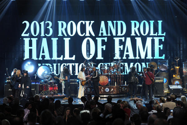 "Inductees Ann Wilson and Nancy Wilson of Heart and Alex Lifeson of Rush, musicians Taylor Hawkins and Dave Grohl of Foo Fighters, inductees Neil Peart and Geddy Lee of Rush, MC Darryl ""D.M.C."" McDaniels, inductee Chuck D of Public Enemy and musicians Gary Clark Jr., John Fogerty, Tom Morello and Chris Cornell perform onstage."