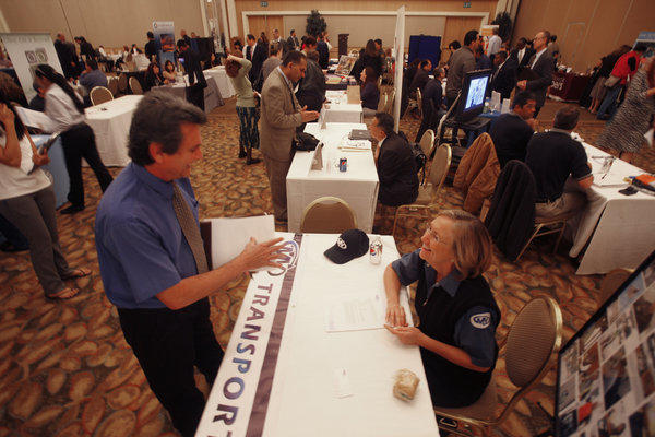 Candidates meet with recruiters at a job fair last month in Orange County.