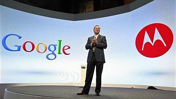 Google CEO Eric Schmidt speaks at a Motorola phone launch event in 2012.