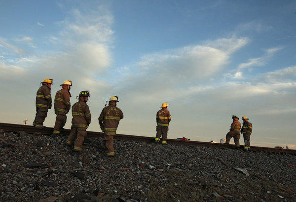 Valley Mills Fire Department personnel gather near the fertilizer plant that exploded in West, Texas.