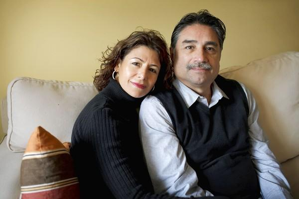 Maricela Perez and Roy Renteria pose for a portrait in their home Friday, March 15, 2013, in Aurora. Perez and Renteria met in 1986 and were married in 1993.