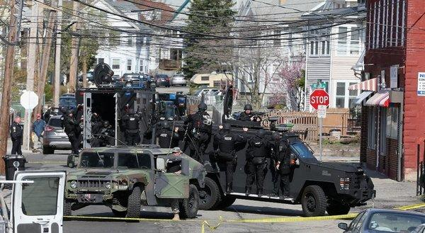 Members of a SWAT team search for 19-year-old bombing suspect Dzhokhar Tsarnaev in Watertown, Mass.