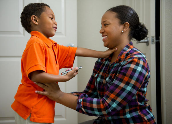 Brittany Lewis and her 5-year-old son, Santana Jones, have a few moments together before heading off to his school on April 10, 2012, in Sacramento, California. Lewis has been juggling parenthood with studying for her medical licensing exam.