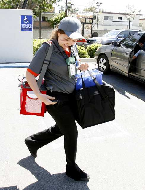 Patricia Camacho makes a delivery at Burger King on Central Avenue in Glendale.