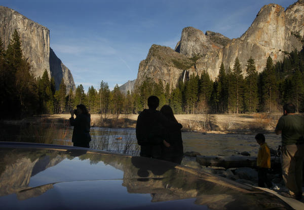 Visitors stop to look, photograph and enjoy the light and scenery of the Yosemite Valley on a cool spring evening.
