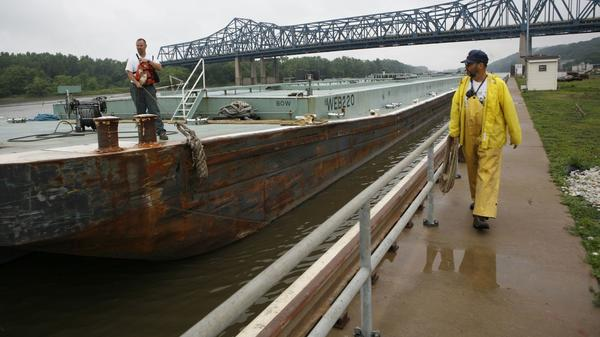 An asphalt barge plies the Illinois River in Peoria in a 2007 file photo.