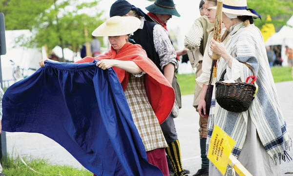 Lynn Brower looks over a blue cape to purchase at the annual Market Fair held at Fort Frederick Saturday...